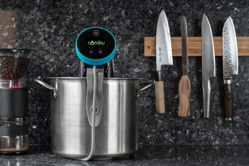 The Nomiku Sous Chef immersion circulator, our 3rd generation Nomiku, is equipped with RFID technology that recognizes each meal. Every time you tap a bag of food's tag to the Nomiku it pulls the information about the food from the cloud and starts cooking. The RFID chip in the meal label tells the Nomiku Sous Chef immersion circulator what is cooking, the precise cook temperature to have it ready in approximately 30 minutes, and when you're running low on meals in your freezer.