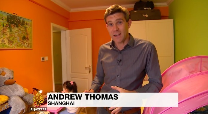 Andrew Thomas, reporter of Al Jazeera English, interviewing onsite