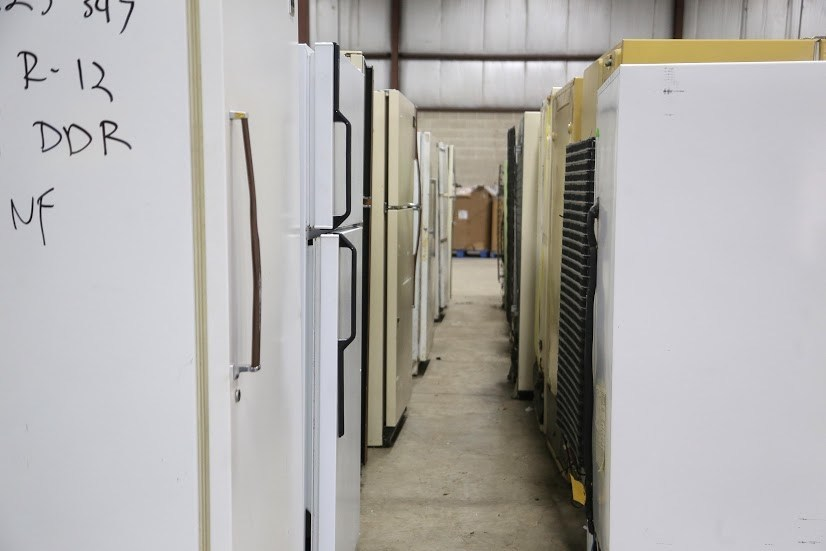 Refrigerators queued for recycling at ARCA's new facility.
