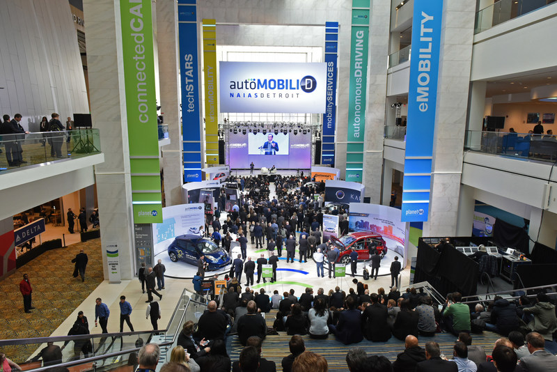 International media and attendees listening to keynote presentation by Carlos Ghosn, Chairman of the Board, Nissan Motor Co., Ltd. at AutoMobili-D during the 2017 North American International Auto Show.