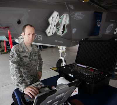 The updated ALIS 2.02 software includes a networking feature to more easily establish connections between deployed locations and home stations. Pictured, a maintainer using ALIS alongside an F-35.
