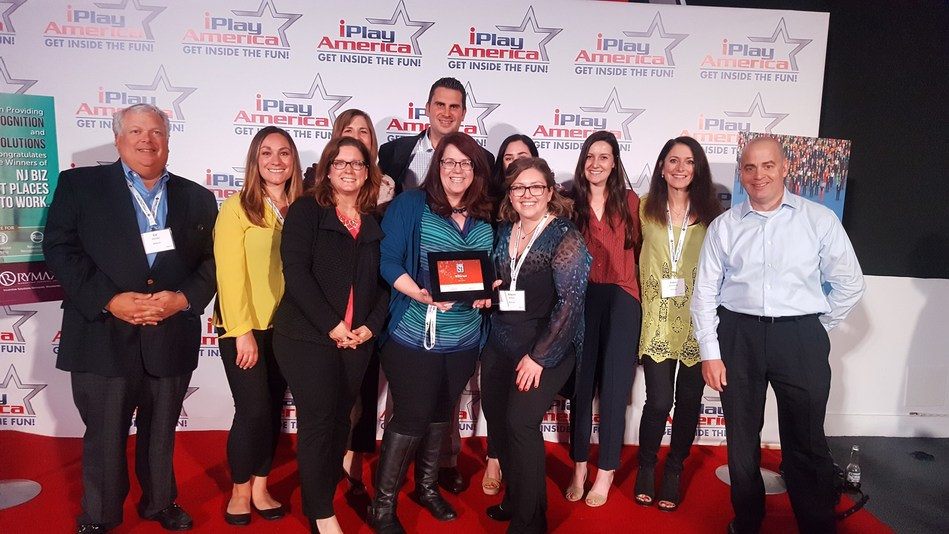 Billtrust team happily accepting the award.