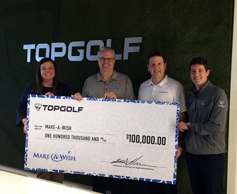 Topgolf CEO Ken May (second from left) and COO Craig Kessler (far right) present $100,000 donation to Make-A-Wish North Texas executives.