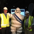 Jeff MacLean, President of Michelin North America (Canada) Inc. and Dr. Gary Polonsky, Chair of the CSTMC Board of Trustees celebrate the kick-off of Michelin's sponsorship of the Zooomobile car building station with the Michelin Man. (CNW Group/Michelin Canada)