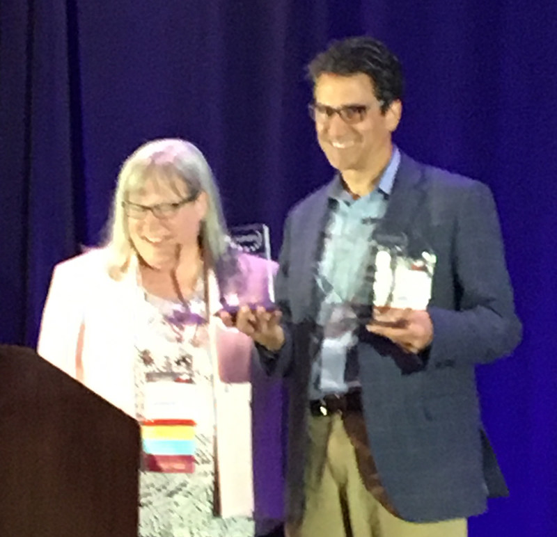NAHAM President Elizabeth Reason, MSA, CHAM, presents AccuReg CEO and Founder Paul Shorrosh with the Carl Satterfield President's Award and an Appreciation Award for his service to NAHAM.