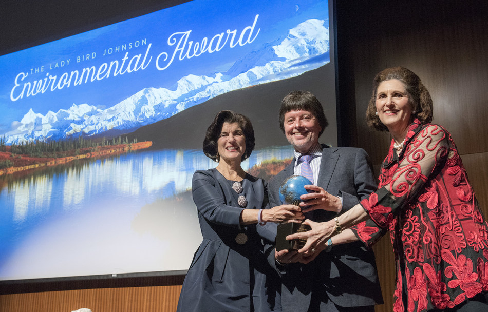 Emmy Award-winning documentary filmmaker Ken Burns receives the 2017 Lady Bird Johnson Environmental Award from President and Lady Bird Johnson's daughters, Luci Baines Johnson, left, and Lynda Johnson Robb during an event held Thursday, April 27, 2017, in the LBJ Auditorium at the LBJ Presidential Library in Austin, Texas. Burns has made documentaries about America's National Parks and the Civil War, among other topics. His new, 10-part documentary about the Vietnam War will air on PBS in Septe