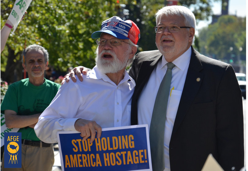 American Federation of Government Employees National President J. David Cox Sr., right, protests the 2013 government shutdown with AFGE members outside the EPA headquarters in Washington.