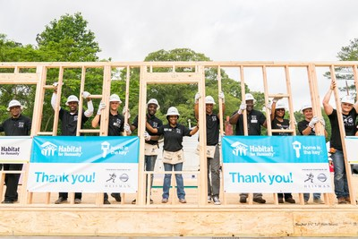"Football legends team up with Habitat for Humanity and Nissan to build ""Heisman House"""