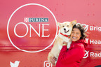 Pictured: Stacy Lynn Fernandes, Nutritional Communications Manager at Nestlé Purina® PetCare Canada, and Purina® ONE spokespuppy, Instagram star Elvis Pawsley, at Barrie Molson Centre celebrating the launch of ONE Score, a new scoring system that enables pet owners to measure and better understand their dog's overall health. Visit PurinaOne.ca for more information. (CNW Group/Purina Canada)