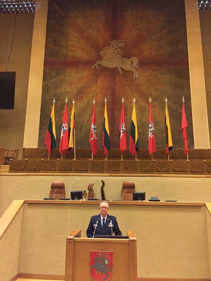 S3's Vice President of Talent Acquisition, Ret. Colonel Ken Huxley, speaks before the Lithuanian Parliament.