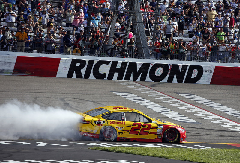 Joey Logano celebrates his Richmond win in the No. 22 Shell-Pennzoil Ford Fusion.