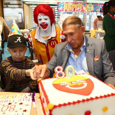 Ronald McDonald House Toronto guest Aiden Verk, 8, and George Cohon, founder of McDonald's Canada, RMHC Canada and McHappy Day, celebrated their birthdays with Ronald McDonald on Monday. McHappy Day is Wednesday, May 3rd and $1 from every hot McCafé beverage, Happy Meal and Big Mac will support RMHC and other children's charities. (CNW Group/McDonald's Canada)