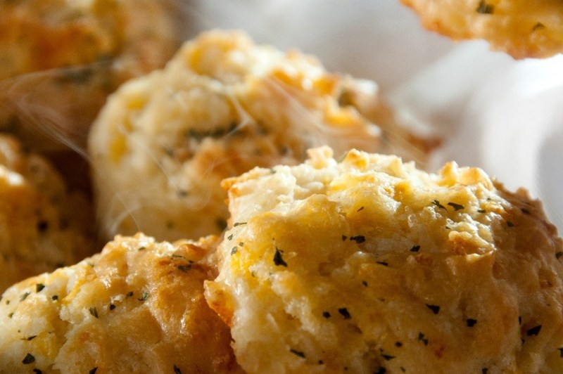 Mixed in-restaurant by hand using a top-secret recipe, Red Lobster's Cheddar Bay Biscuits are made every 15 minutes with quality-aged Cheddar cheese and finished with a savory garlic topping.