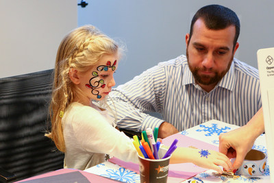 Mark O'Grady, Information Systems Auditor, and his daughter at an OppenheimerFunds Children's event.