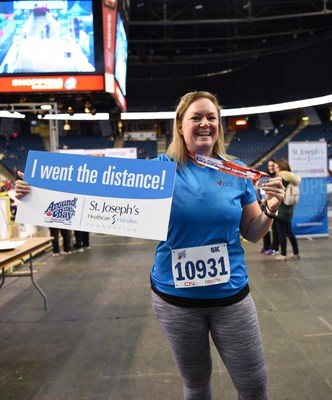 Heather McSevney, long-time Around the Bay runner and fundraiser, went the distance because without St. Joseph's Healthcare Hamilton's dedicated staff, her dad, who received a kidney transplant in 2016, wouldn't be here today. (CNW Group/St. Joseph's Healthcare Foundation)