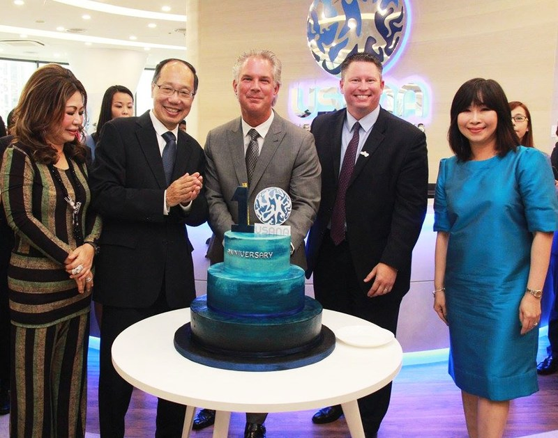 USANA Executives with the 10th Anniversary cake.