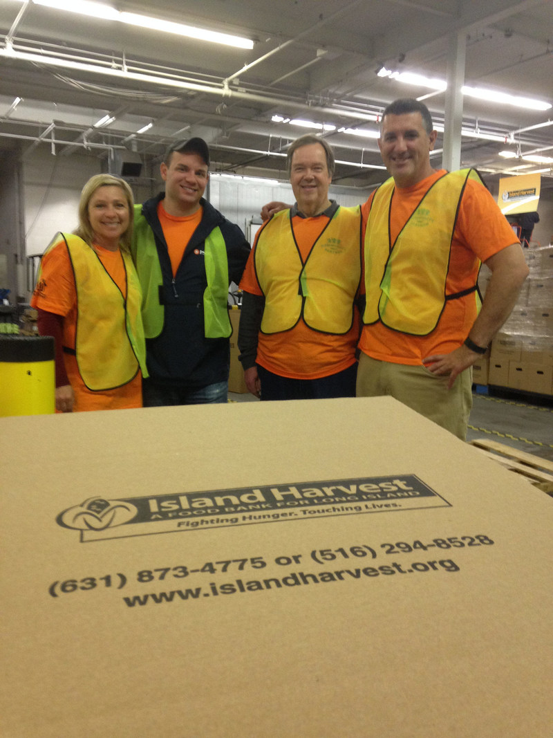 PSEG Long Island employees volunteer at Island Harvest during National Volunteer Week 2017.