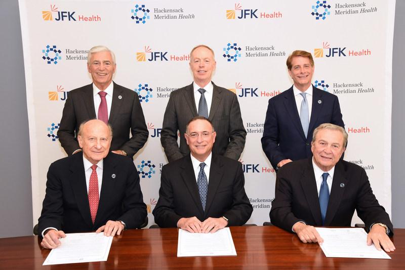 Hackensack Meridian Health and JFK Health announced a definitive agreement to merge.  At the signing ceremony were (top left to right) John K. Lloyd, Co-CEO, Hackensack Meridian Health; Raymond Fredericks, president & CEO, JFK Health; Robert C. Garrett, Co-CEO, Hackensack Meridian Health; (bottom left to right) Gordon N. Litwin, Co-Chair, Hackensack Meridian Health; Michael Kleiman, DMD, chairman of JFK Health; and Joseph Simunovich, Co-Chair Hackensack Meridian Health.