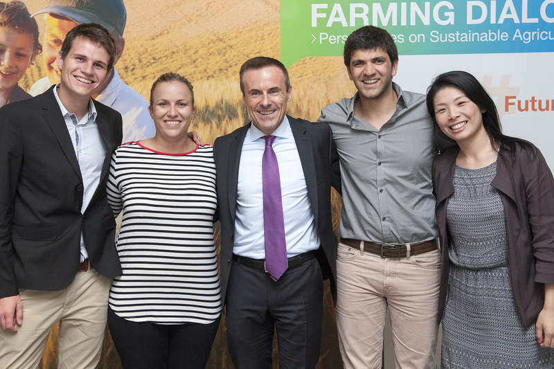 Liam Condon (center), member of the Board of Management of Bayer AG and head of the Crop Science Division, joins delegates from the 2015 Youth Ag-Summit.