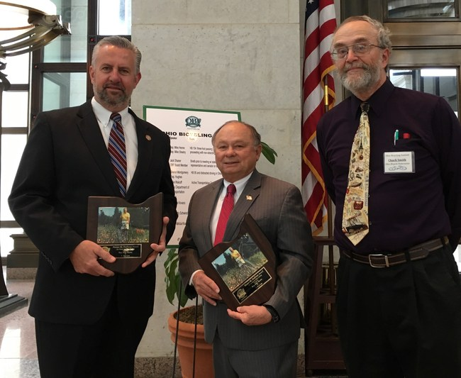 House Representatives Mike Henne(R-40)(http://www.ohiohouse.gov/michael-henne) and Mike Sheehy(D-46)(http://www.ohiohouse.gov/michael-sheehy) receiving the H.M. Huffman Award for Service to Ohio Bicycling from OBF Chair, Mr. Chuck Smith during the IV Ohio Bicycling Summit