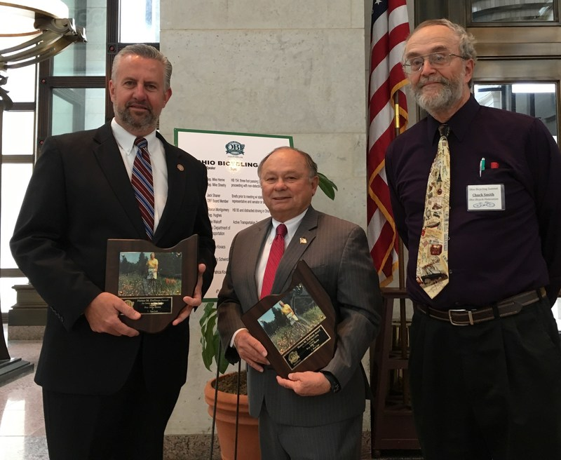 House Representatives Mike Henne(R-40)(https://www.ohiohouse.gov/michael-henne) and Mike Sheehy(D-46)(https://www.ohiohouse.gov/michael-sheehy) receiving the H.M. Huffman Award for Service to Ohio Bicycling from OBF Chair, Mr. Chuck Smith during the IV Ohio Bicycling Summit