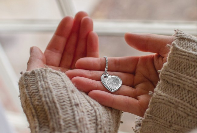 Stay close and connected with a precious fingerprint engraved on an heirloom pendant. Beautifully Symbolic and undeniably comforting, it's a touch of love and memory you can take wherever you go.