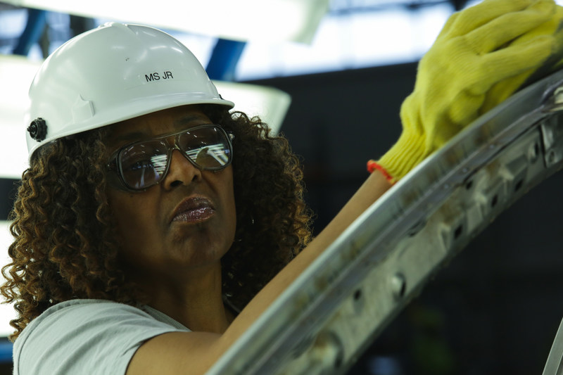 A Toyota R&D employee inspects the frame of a vehicle during a recent study at the newly opened TMNA R&D Purchasing and Prototype Development centers in York Township, Mich.