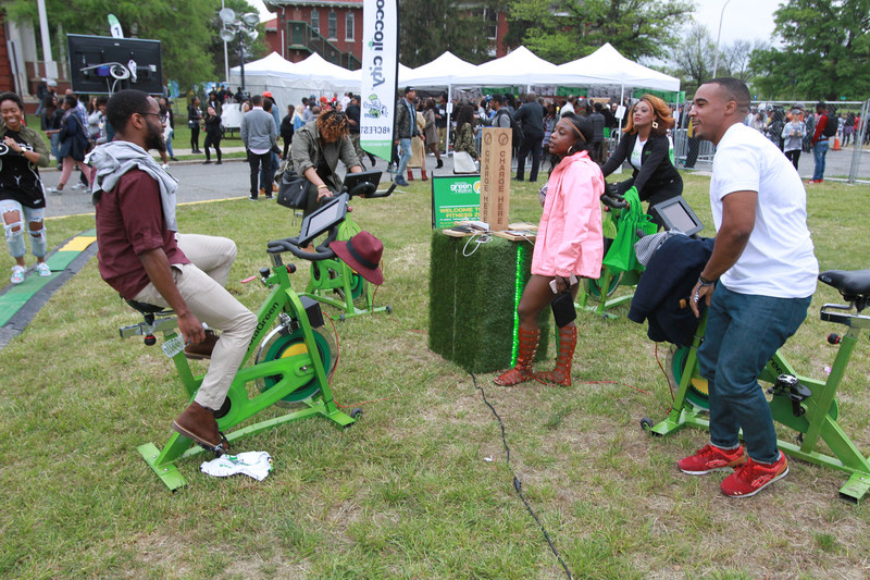 In an effort to charge their phones, festival-goers take a spin on electric-fueled stationary bikes at the Toyota Green Initiative activation space during the 2016 Broccoli City Festival in Washington D.C. Toyota is back as a major sponsor of this year's eco-friendly music festival. This event is just one of many the brand will sponsor throughout the year under its African-American millennial-focused sustainability platform, the Toyota Green Initiative. (Photo: Donald Traill)