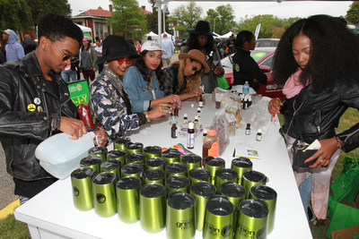 Sustainability expert and Toyota Green Initiative coalition member, Yoli Ouiya, shows festival-goers how to make their own eco-friendly body oils during the 2016 Broccoli City Festival in Washington, D.C. Toyota is back as a major sponsor of this year's eco-friendly music festival. This event is just one of many the brand will sponsor throughout the year under its African-American millennial-focused sustainability platform, the Toyota Green Initiative. (Photo: Donald Traill)