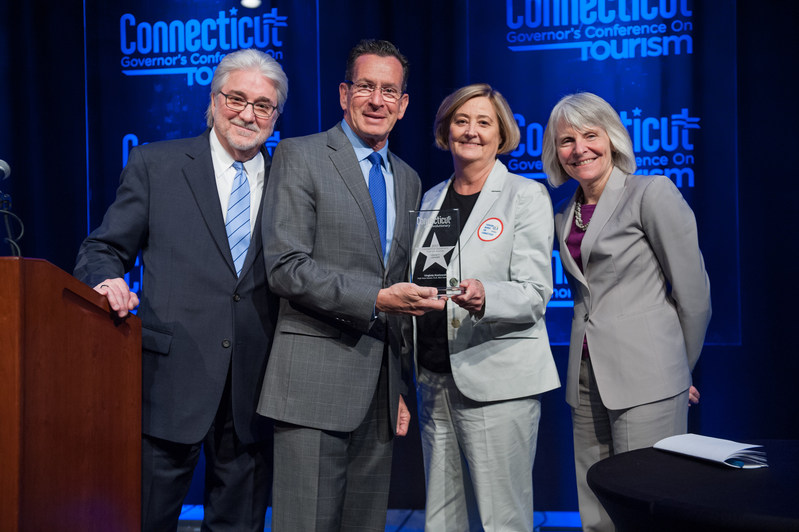 Virginia Kozlowski, Executive Director of Visit New Haven, Connecticut Lodging Association and REX Development, receives the 2017 Connecticut Governor's Tourism Award for Tourism Legacy Leader. From left: Randy Fiveash, Director, Connecticut Office of Tourism; Governor Dannel P. Malloy; Virginia Kozlowski; Catherine Smith, Commissioner, Connecticut Department of Economic and Community Development.