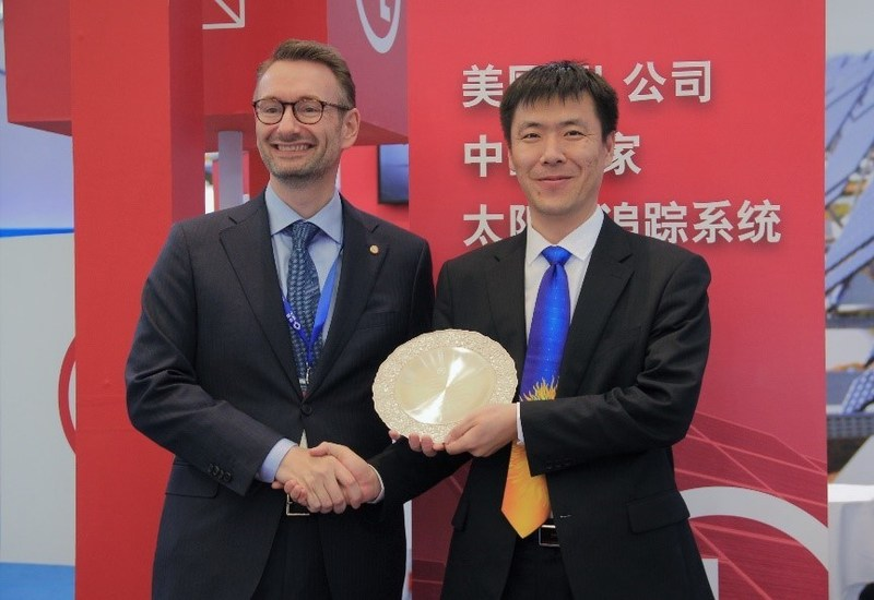 Mr. Bruce Wang, the CTO of Arctech Solar was granted the UL certificate by Edvard Jensen, general manager of UL company