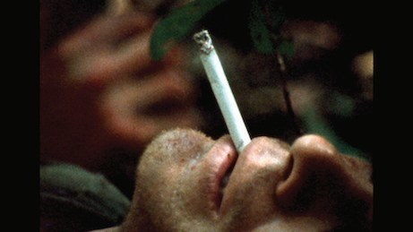 A soldier from the 327th Airborne takes a break as he awaits his medivac, made difficult by the triple-canopy Vietnamese jungle.