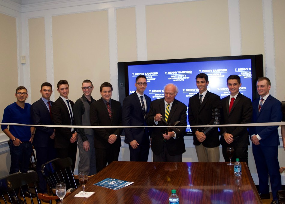 T. Denny Sanford joins Long Island University's Sanford Scholars to officially open the LIU T. Denny Sanford Innovation and Entrepreneurship Institute at the LIU Post campus in Brookville, New York.