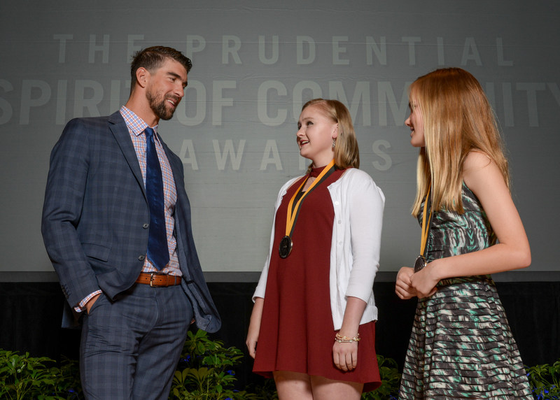 Olympic gold medalist Michael Phelps congratulates Elizabeth Lipp, 16, of Mountain Brook (center) and Louise Adair, 13, of Tuscaloosa (right) on being named Alabama's top two youth volunteers for 2017 by The Prudential Spirit of Community Awards. Elizabeth and Louise were honored at a ceremony on Sunday, May 7 at the Smithsonian's National Museum of Natural History, where they each received a $1,000 award.