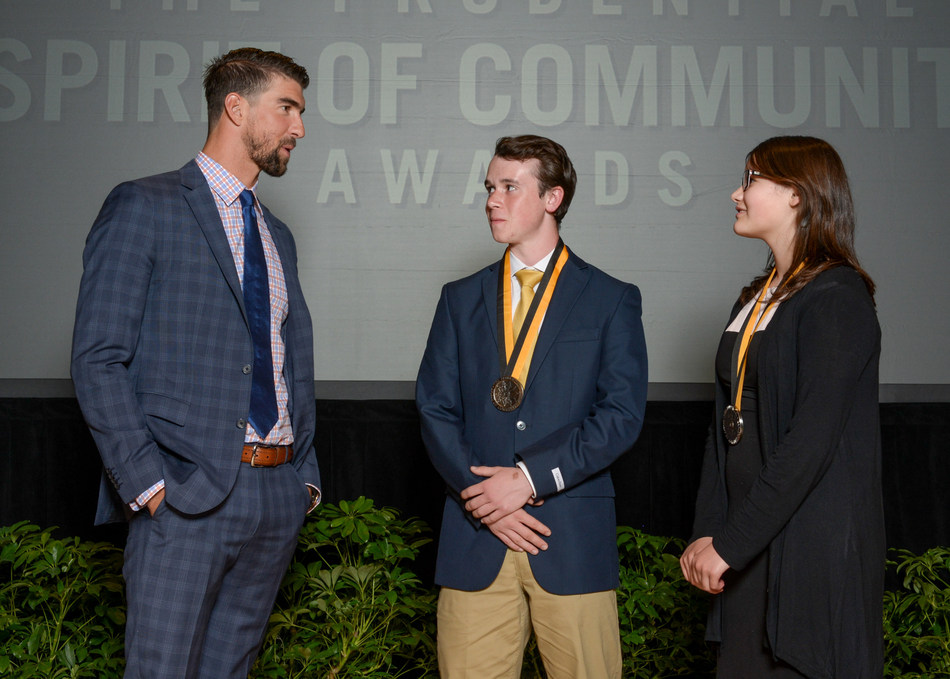 Olympic gold medalist Michael Phelps congratulates Adam Skelton, 17, of Anchorage (center) and Leena Robinson, 13, of Nenana (right) on being named Alaska's top two youth volunteers for 2017 by The Prudential Spirit of Community Awards. Adam and Leena were honored at a ceremony on Sunday, May 7 at the Smithsonian's National Museum of Natural History, where they each received a $1,000 award.