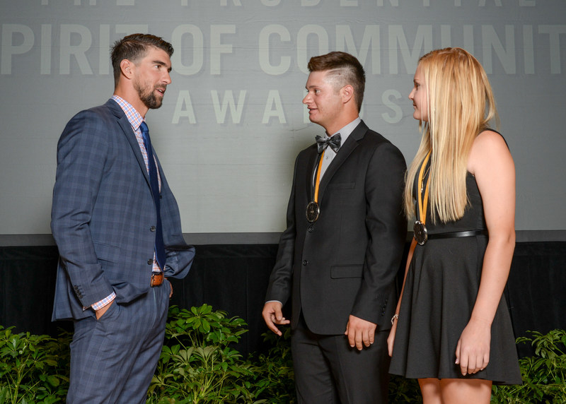 Olympic gold medalist Michael Phelps congratulates Emery Miller, 18 (center) and Lauren Basye, 13 (right), both of Gilbert, on being named Arizona's top two youth volunteers for 2017 by The Prudential Spirit of Community Awards. Emery and Lauren were honored at a ceremony on Sunday, May 7 at the Smithsonian's National Museum of Natural History, where they each received a $1,000 award.