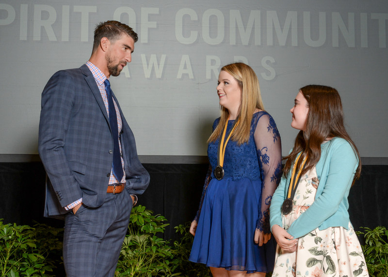 Olympic gold medalist Michael Phelps congratulates Emily Richey, 18, of Paris (center) and Gable Sloan, 11, of Fayetteville (right) on being named Arkansas' top two youth volunteers for 2017 by The Prudential Spirit of Community Awards. Emily and Gable were honored at a ceremony on Sunday, May 7 at the Smithsonian's National Museum of Natural History, where they each received a $1,000 award.