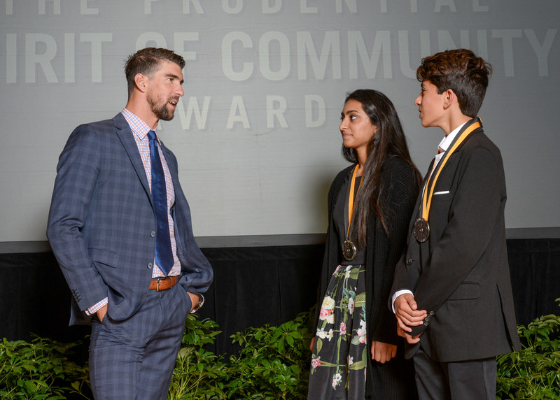 Olympic gold medalist Michael Phelps congratulates Meghana Reddy, 18, of La Mesa (center) and Kenan Pala, 13, of San Diego (right) on being named California's top two youth volunteers for 2017 by The Prudential Spirit of Community Awards. Meghana and Kenan were honored at a ceremony on Sunday, May 7 at the Smithsonian's National Museum of Natural History, where they each received a $1,000 award.