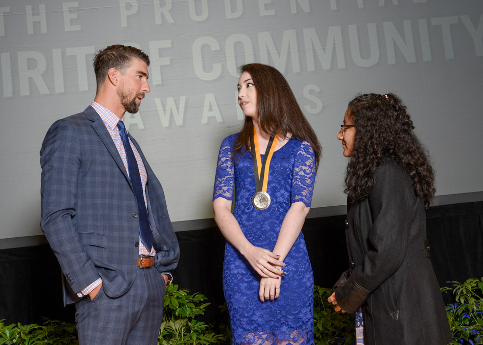 Olympic gold medalist Michael Phelps congratulates Emma Albertoni, 18, of Arvada (center) and Breanna Remigio, 14, of Aurora (right) on being named Colorado's top two youth volunteers for 2017 by The Prudential Spirit of Community Awards. Emma and Breanna were honored at a ceremony on Sunday, May 7 at the Smithsonian's National Museum of Natural History, where they each received a $1,000 award.