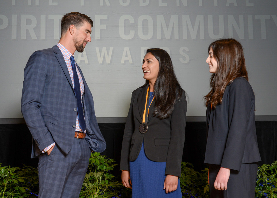 Olympic gold medalist Michael Phelps congratulates Isha Dalal, 17 (center) and Rachel Weintraub, 13 (right), both of Trumbull, on being named Connecticut's top two youth volunteers for 2017 by The Prudential Spirit of Community Awards. Isha and Rachel were honored at a ceremony on Sunday, May 7 at the Smithsonian's National Museum of Natural History, where they each received a $1,000 award.