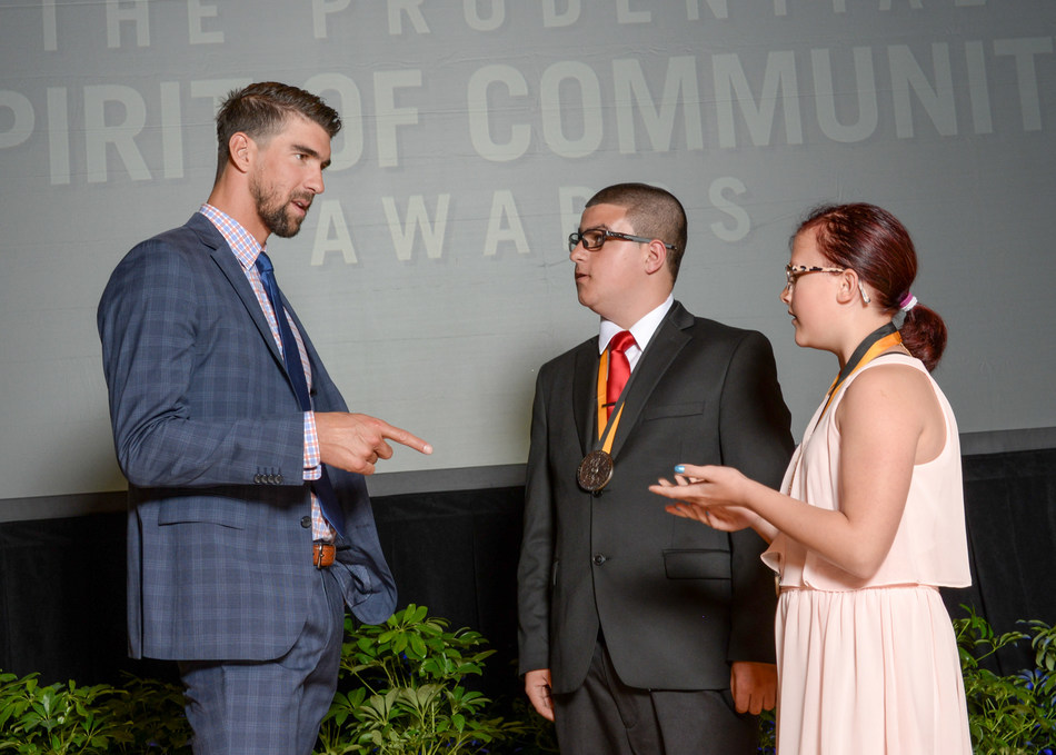 Olympic gold medalist Michael Phelps congratulates Joseph Thomasson, 15, of Lewiston (center) and Shelby Kettler, 10, of Pocatello (right) on being named Idaho's top two youth volunteers for 2017 by The Prudential Spirit of Community Awards. Joseph and Shelby were honored at a ceremony on Sunday, May 7 at the Smithsonian's National Museum of Natural History, where they each received a $1,000 award.