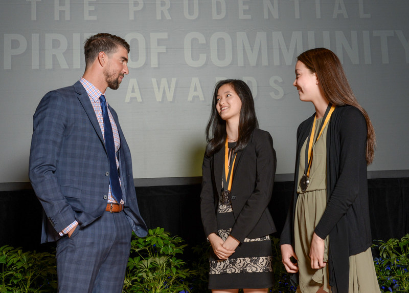 Olympic gold medalist Michael Phelps congratulates Grace Zhang, 18, of Carmel (center) and Tara Harmon, 14, of Zionsville (right) on being named Indiana's top two youth volunteers for 2017 by The Prudential Spirit of Community Awards. Grace and Tara were honored at a ceremony on Sunday, May 7 at the Smithsonian's National Museum of Natural History, where they each received a $1,000 award.