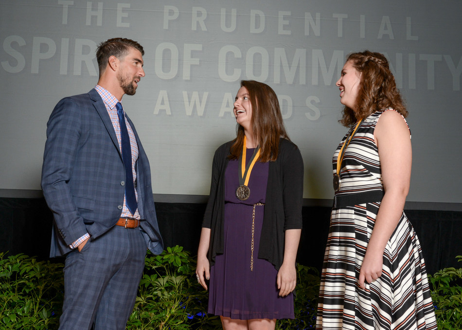 Olympic gold medalist Michael Phelps congratulates Jennifer Jenks, 17, of Aurora (center) and Aliza Woodford, 14, of Emmetsburg (right) on being named Iowa's top two youth volunteers for 2017 by The Prudential Spirit of Community Awards. Jennifer and Aliza were honored at a ceremony on Sunday, May 7 at the Smithsonian's National Museum of Natural History, where they each received a $1,000 award.