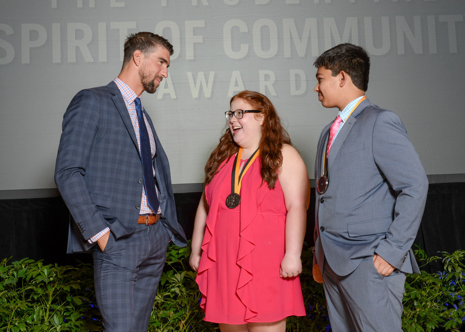 Olympic gold medalist Michael Phelps congratulates Anna-Maria Beck, 17 (center) and Andrew Dunn, 14 (right), both of Louisville, on being named Kentucky's top two youth volunteers for 2017 by The Prudential Spirit of Community Awards. Anna-Maria and Andrew were honored at a ceremony on Sunday, May 7 at the Smithsonian's National Museum of Natural History, where they each received a $1,000 award.