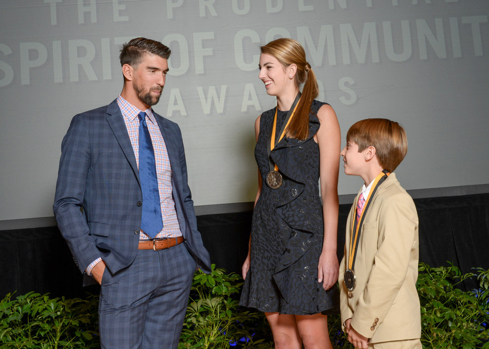 Olympic gold medalist Michael Phelps congratulates Anna Katherine Tollett, 16, of Ruston (center) and Zach Morgan, 12, of Denham Springs (right) on being named Louisiana's top two youth volunteers for 2017 by The Prudential Spirit of Community Awards. Anna Katherine and Zach were honored at a ceremony on Sunday, May 7 at the Smithsonian's National Museum of Natural History, where they each received a $1,000 award.
