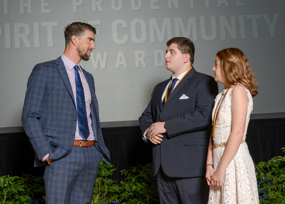 Olympic gold medalist Michael Phelps congratulates Casey Arruda, 17, of Somerset (center) and Ella Morrison, 11, of Middleboro (right) on being named Massachusetts' top two youth volunteers for 2017 by The Prudential Spirit of Community Awards. Casey and Ella were honored at a ceremony on Sunday, May 7 at the Smithsonian's National Museum of Natural History, where they each received a $1,000 award.