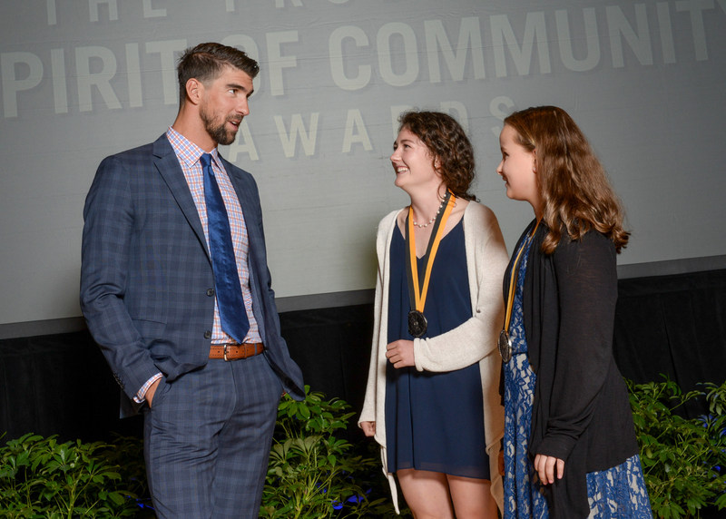 Olympic gold medalist Michael Phelps congratulates Kathleen Waeldner, 18, of Yarmouth (center) and Bella Rossborough, 12, of Kennebunk (right) on being named Maine's top two youth volunteers for 2017 by The Prudential Spirit of Community Awards. Kathleen and Bella were honored at a ceremony on Sunday, May 7 at the Smithsonian's National Museum of Natural History, where they each received a $1,000 award.