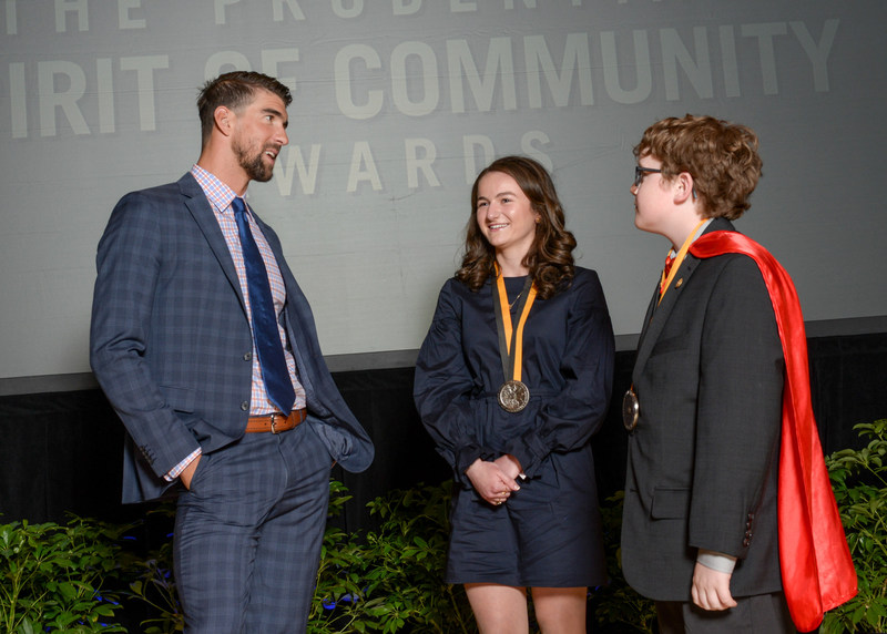 Olympic gold medalist Michael Phelps congratulates Sarah Maisano, 17, of Clinton Township (center) and Ewan Drum, 10, of New Haven (right) on being named Michigan's top two youth volunteers for 2017 by The Prudential Spirit of Community Awards. Sarah and Ewan were honored at a ceremony on Sunday, May 7 at the Smithsonian's National Museum of Natural History, where they each received a $1,000 award.