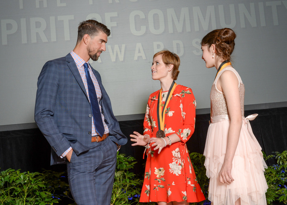 Olympic gold medalist Michael Phelps congratulates Miranda Mead, 17, of Plymouth (center) and Ariana Feygin, 12, of Excelsior (right) on being named Minnesota's top two youth volunteers for 2017 by The Prudential Spirit of Community Awards. Miranda and Ariana were honored at a ceremony on Sunday, May 7 at the Smithsonian's National Museum of Natural History, where they each received a $1,000 award.