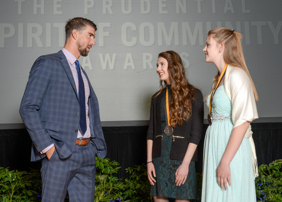 Olympic gold medalist Michael Phelps congratulates Sophia Skwarchuk, 18, of Kalispell (center) and Hannah Halvorson, 13, of Laurel (right) on being named Montana's top two youth volunteers for 2017 by The Prudential Spirit of Community Awards. Sophia and Hannah were honored at a ceremony on Sunday, May 7 at the Smithsonian's National Museum of Natural History, where they each received a $1,000 award.